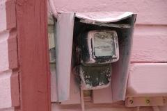 St.-Maarten-1302-Philipsburg-Watermeter-bij-roze-houten-huis